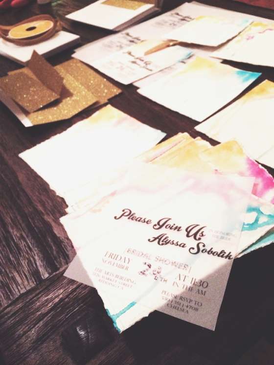 the sheer vellum overlays, which did the job of holding event info without covering or competing with the painted invite